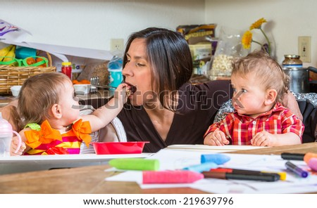 A Baby feeds her mother at breakfast