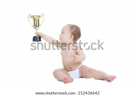 A baby holding gold trophy cup on a white background - stock photo