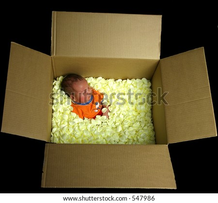 a baby in soft foam packaging in a box - stock photo