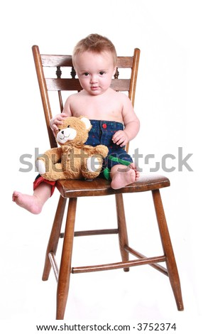 A baby learning to sit up on a big chair