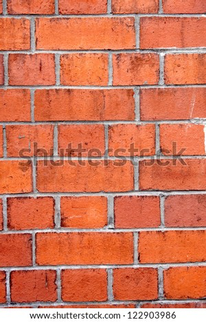 A back ground of square red brick - stock photo