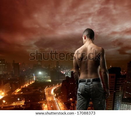 a back of  a man and a city
