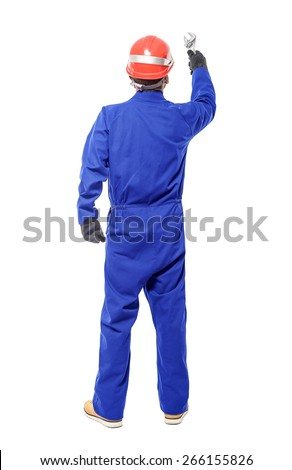 A back view of a worker holding a wrench isolated on white background. - stock photo