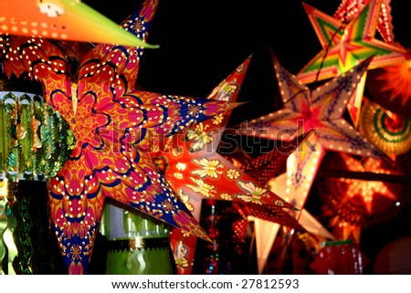 A backgorund with a view of beautifully designed colorful lanterns (also locally called as skylanters) decoration lit of the occasion of Diwali / Christmas festival in India. - stock photo