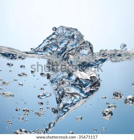 A background abstract of bubbles floating to the surface of water - stock photo