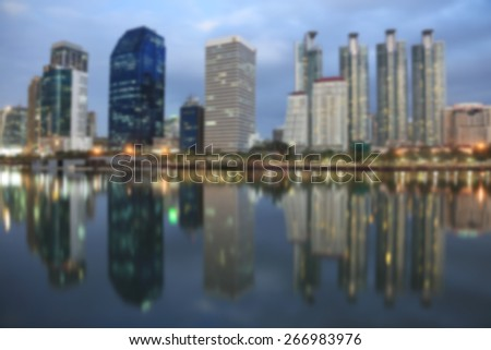A background blur image of buildings that make up part of the skyline of Bangkok Thailand - stock photo