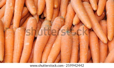A Background Image of Bright Orange Carrot Vegetables. - stock photo