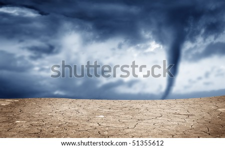 A background image of dried soil and tornado - stock photo
