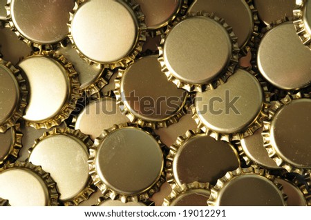 a background of brass bottle caps - stock photo
