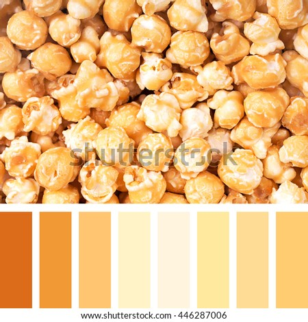 A background of caramel popcorn in a colour palette with complimentary colour swatches - stock photo