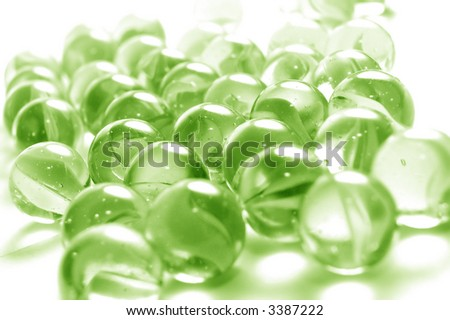 A background of colourful glass marbles. Green version - stock photo