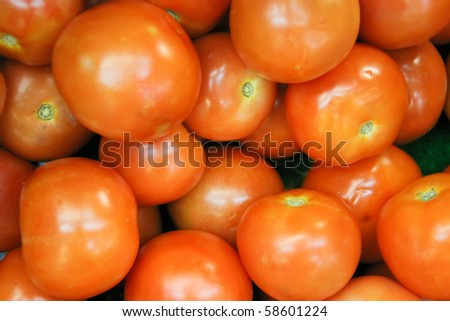 A background of fresh tomatoes for sale at a market