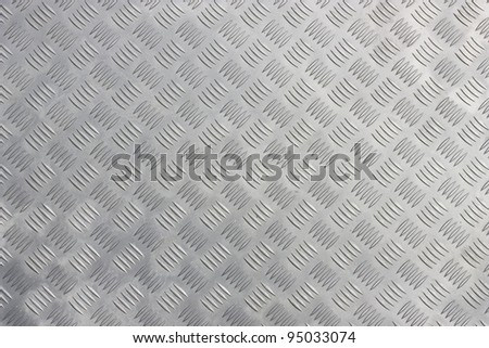 A background of metal diamond plate. - stock photo