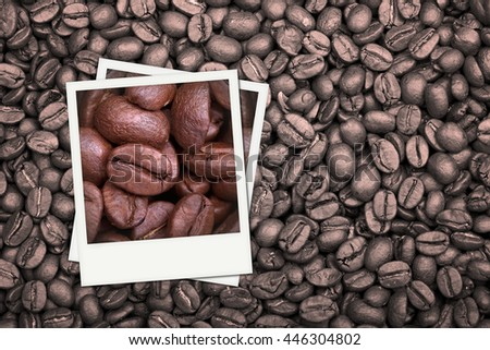 A background of monotone coffee beans with colour photos of additional coffee beans in closeup. - stock photo