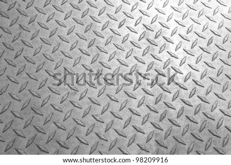 A background of old metal diamond plate. - stock photo