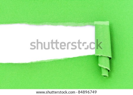 A background of torn green paper.