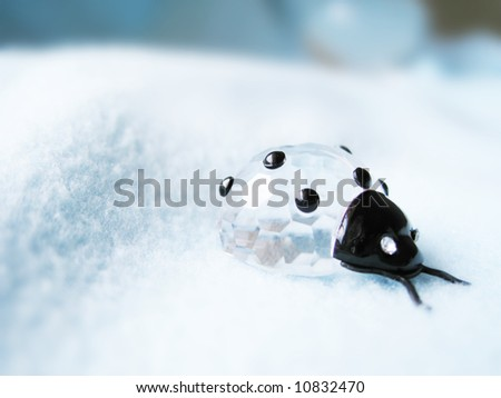 a background with a crystal ladybird