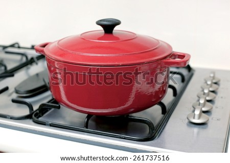 A backing pot isolated on a stove top - stock photo