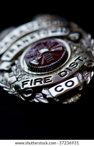 A badge from a fire fighter on a dark background