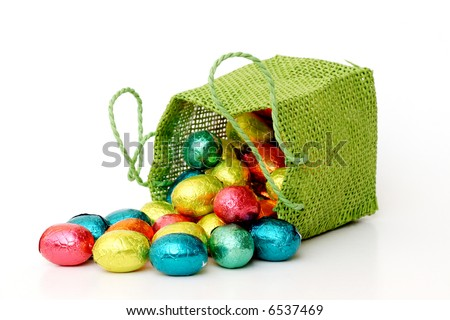 a bag full of chocolate eggs wrapped in gold on white - stock photo