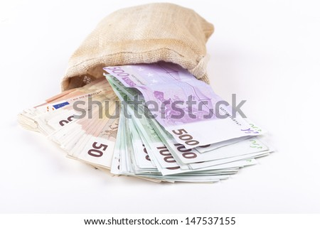 A bag full with euro banknotes pouring out isolated on white background