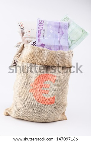 A bag full with euro banknotes with euro sign on the bag isolated on white background - stock photo