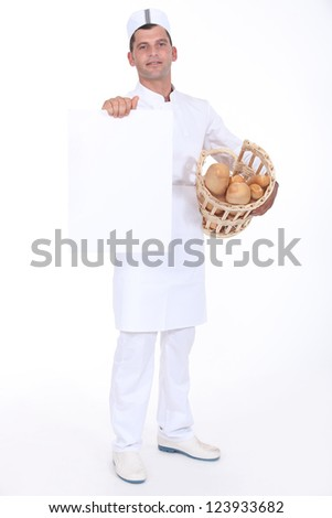 A baker presenting a blank poster. - stock photo