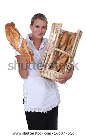 A baker showing off her bread - stock photo