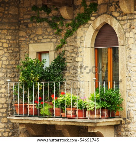 a balcony with flowers - stock photo