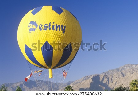 A balloon in flight during the Gordon Bennett Balloon Race at Palm Springs, California - stock photo