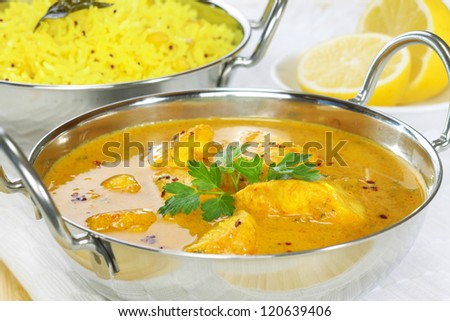 A balti dish with a Peshwari style chicken curry, with basmati rice and lemon in the background.. - stock photo
