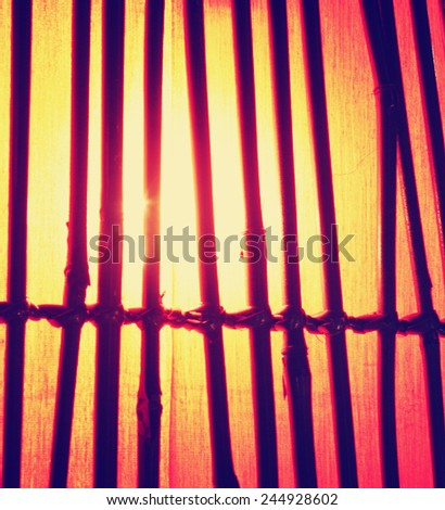 a bamboo lamp toned with a retro vintage instagram filter effect - stock photo