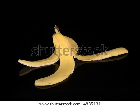 A banana peel against a black background. - stock photo