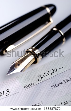 a bank check with fountain pen - stock photo