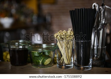 A bar counter top showing bartender equipment   - stock photo