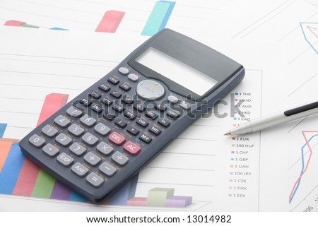 Bar graphs calculator pen on it stock photo royalty free 13014982 a bar graphs and calculator and pen on it ccuart Image collections