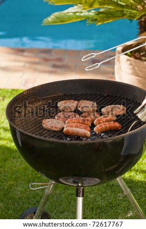 A barbecue in the garden - stock photo