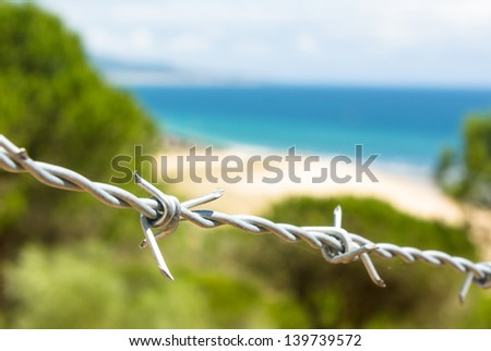 A barbed wire in a beach - stock photo