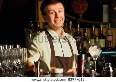 A barman at work - indoors - stock photo