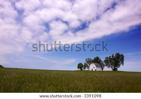 A barn in Iowa on a beautiful day in May. - stock photo