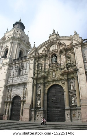 A baroque colonial church highlights the plaza mayor in Lima Peru - stock photo