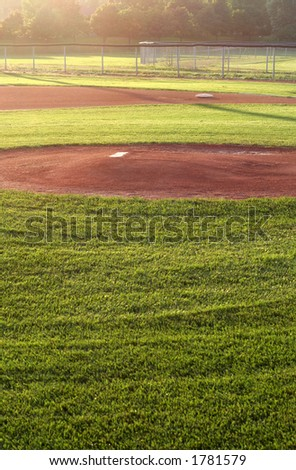 A baseball field cast in early morning light. - stock photo