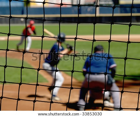 A baseball net protecting viewers from stray balls. - stock photo