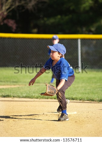 A baseball player going for a grounder - stock photo