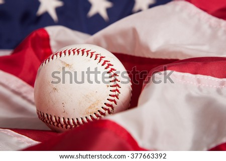 A baseball with an American Flag background