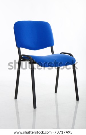 a basic cloth covered office chair, isolated on white - stock photo