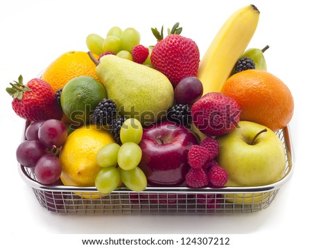 A basket filled with a variety of fruit. - stock photo
