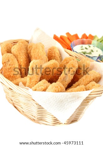 A basket of crispy chicken fingers with platter of vegetables and dip on a white background - stock photo