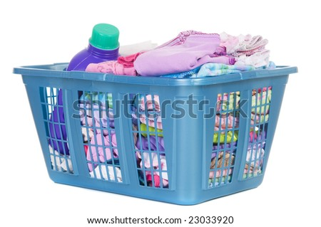 A basket of folded laundry. Children's clothes never end. Isolated on white - stock photo