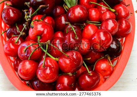 A basket of organically grown bing cherries in a local fruit market at Ellensburg, Washington, US - stock photo